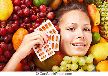 Woman with fruit and vitamin pill. - Young woman with fruit...