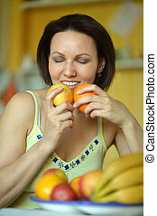 Woman with fruits at home