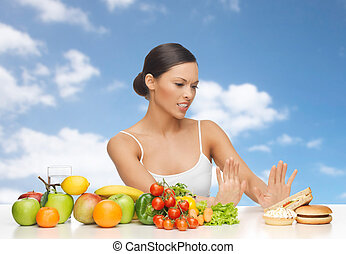 woman with fruits rejecting fast food