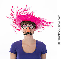 Woman with funny carnival mask and hat