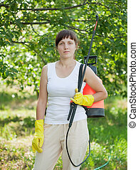 woman with garden spray
