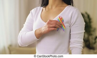 woman with gay or lgbt pride awareness ribbon - homosexual...