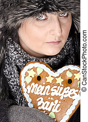 woman with gingerbread heart