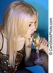 woman with glass of champagne l