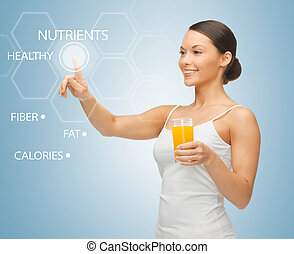 woman with glass of juice and virtual screen