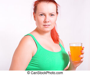 woman with glass of juice