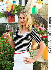 Woman with glass of red wine at the winery.