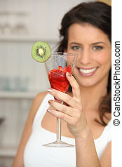 Woman with glass of strawberries