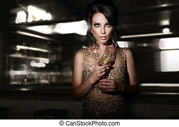 Woman with glass of  wine .