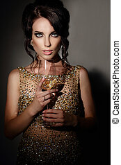Woman with glass of  wine.