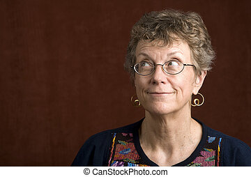 Woman with glasses looking up