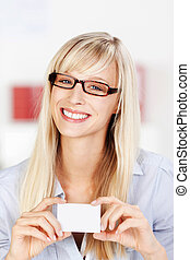 Woman with glasses showing card