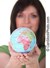 Woman with globe in hand