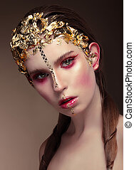 Woman with gold face make up.