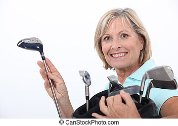 Woman with golf bag