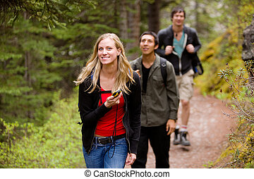 Woman with GPS in Forest