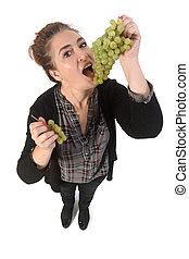 woman with grape fruit on white background