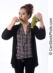 woman with grape on white background