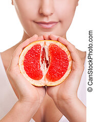woman with grapefruit in hands close-up