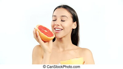 Woman with Grapefruit Isolated on White - Attractive...