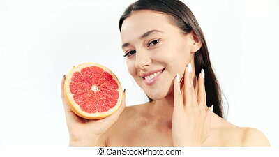 Woman with Grapefruit Isolated on White - Attractive woman...