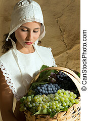 Woman with grapes in basket
