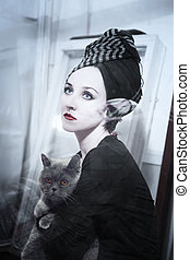 Woman with gray cat