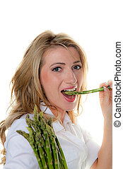 woman with green asparagus