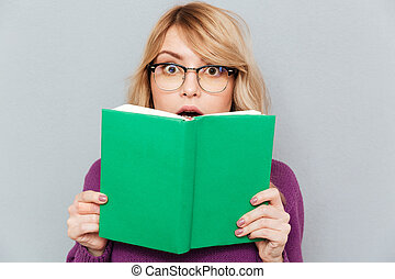 Woman with green book