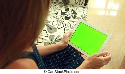 Woman with green chromakey tablet - Woman holding tablet pc...