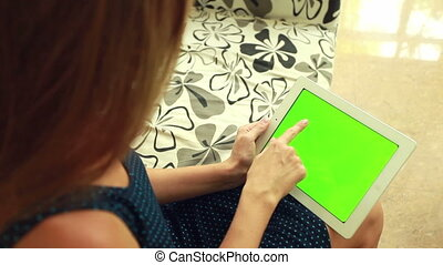 Woman with green chromakey tablet