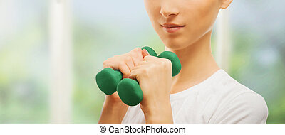 Woman with green dumbbell
