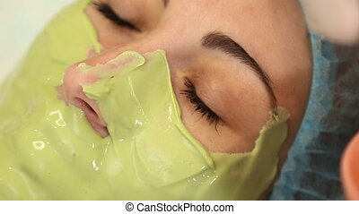 woman with green mask on her face