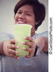 Woman with green vegetable smoothie
