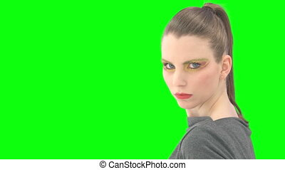 Woman with greenscreen and alpha matte