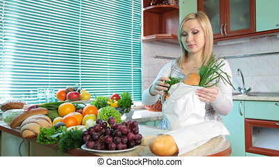 woman with Groceries in kitchen