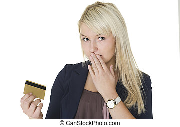 Woman with guilty look holding credit card - Beautiful...
