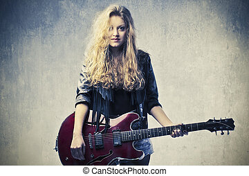 Woman with guitar - Rocker woman with guitar