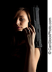 Woman with gun - Shot of a beautiful girl holding gun,...