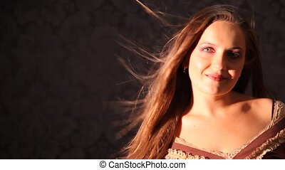 woman with hair fluttering in wind in studio