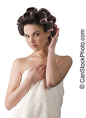 woman with hair rollers - Young beautiful girl having hair ...