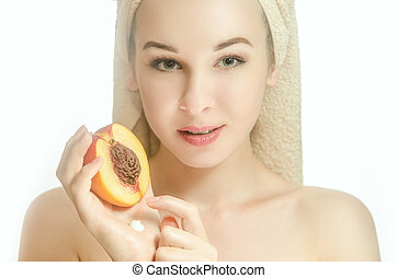 Woman with half of peach and cream on her hand - Woman with...