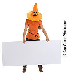 Woman with Halloween hat pulled over head holding blank billboard