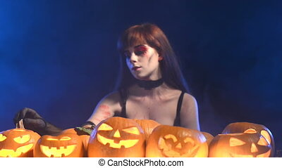 Woman with Halloween pumpkins