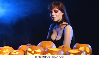 Woman with Halloween pumpkins - Woman with Halloween makeup...