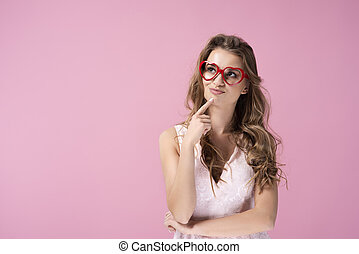Woman with hand on chin looking at copy space