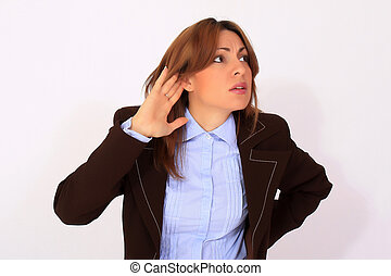 Woman with hand on ear