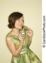 Woman with handheld radio. - Pretty Caucasian mid-adult...