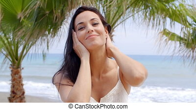 Woman with Hands in Hair on Tropical Beach