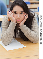 Woman with head in hands in classroom